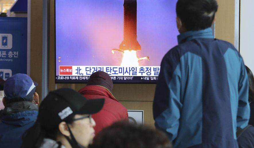 People watches a television screen showing a file image of North Korea's missile launch during a news program at the Seoul Railway Station in Seoul, South Korea, Saturday, March 21, 2020. North Korea on Saturday fired two presumed short-range ballistic missiles into the sea, South Korea's military said, as it continues to expand military capabilities amid deadlocked nuclear negotiations with the Trump administration and a crippling global health crisis. (AP Photo/Ahn Young-joon)