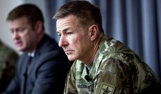 In this file photo, Secretary of the Army Ryan McCarthy, left, accompanied by Gen. James McConville, Chief of Staff of the Army, right, speaks at a news conference at U.S. Army Medical Research and Development Command at Fort Detrick in Frederick, Md., Thursday, March 19, 2020. Gen. McConville (AP Photo/Andrew Harnik)  **FILE**