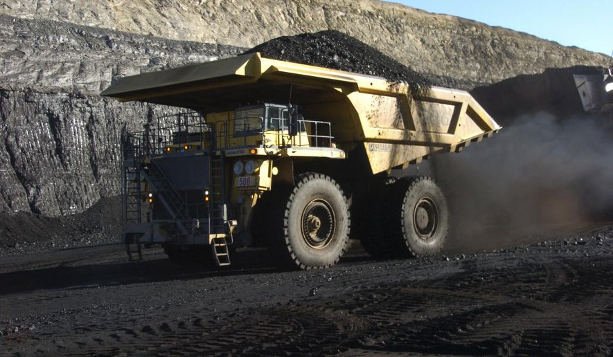 FILE - In this Nov. 15, 2016, file photo, a haul truck with a 250-ton capacity carries coal from the Spring Creek strip mine near Decker, Mont. The lobbying arm of the U.S. coal industry is asking for hundreds of millions of dollars in royalty relief, tax cuts and other breaks to help companies ride out financial crisis brought on by the corona virus pandemic. (AP Photo/Matthew Brown, File)