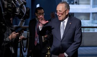 Senate Minority Leader Sen. Chuck Schumer of N.Y., speaks to reporters as he arrives for a meeting to discuss the coronavirus relief bill on Capitol Hill, Friday, March 20, 2020, in Washington. (AP Photo/Andrew Harnik)