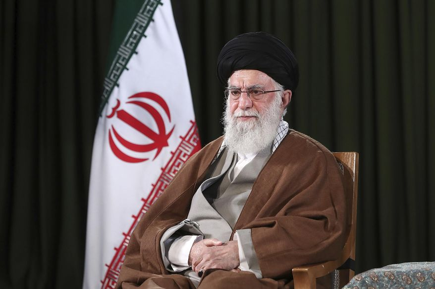 In this photo released on Friday, March 20, 2020 by the official website of the office of the Iranian supreme leader, Supreme Leader Ayatollah Ali Khamenei poses for a portrait prior to delivering his message for the Iranian New Year, or Nowruz, in Tehran, Iran. Ayatollah Ali Khamenei and President Hassan Rouhani in separate new year messages vowed to overcome the new coronavirus and increase economic growth. (Office of the Iranian Supreme Leader via AP)