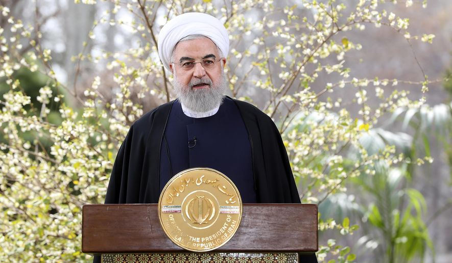 In this photo released on Friday, March 20, 2020, by the official website of the office of the Iranian Presidency, President Hassan Rouhani delivers a message for the Iranian New Year, or Nowruz, in Tehran, Iran. (Iranian Presidency Office via AP) ** FILE **