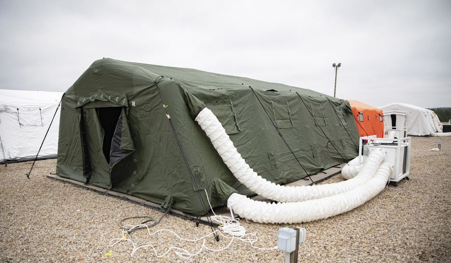 This photo provided by the U.S. Army shows large tents The 82nd Airborne Division has established to provide accommodations for up to 600 soldiers, shown March 17, 2020 at Fort Bragg, N.C. In one of Bragg's remote training areas, large tents have popped up over the last few days to house hundreds of 82nd Airborne Division troops that are returning to the base from Afghanistan and other Middle East deployments. (U.S. Army photo by Sgt. 1st Class Zach VanDyke via AP)