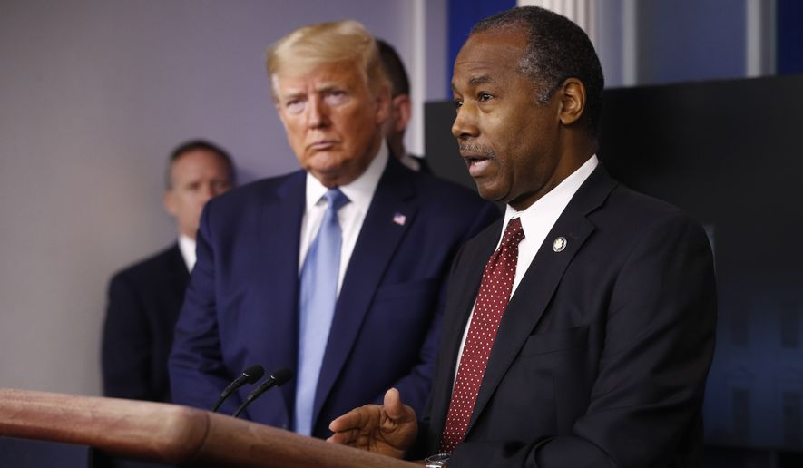 President Donald Trump listens as Housing and Urban Development Secretary Ben Carson speaks during a coronavirus task force briefing at the White House, Saturday, March 21, 2020, in Washington. (AP Photo/Patrick Semansky)