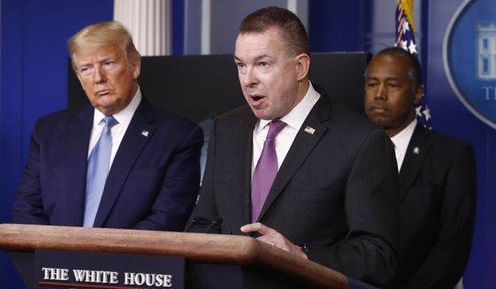 Administrator for FEMA Peter Gaynor speaks as President Donald Trump, left, and Housing and Urban Development Secretary Ben Carson listen during a coronavirus task force briefing at the White House, Saturday, March 21, 2020, in Washington. (AP Photo/Patrick Semansky)