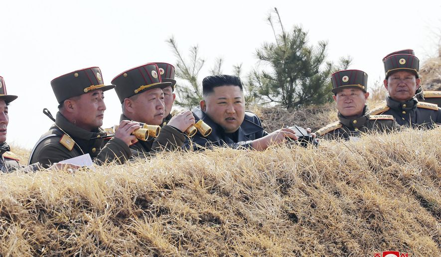 "In this Friday, March 20, 2020, photo provided by the North Korean government, North Korean leader Kim Jong Un supervises an artillery firing competition between army units in the country's west in North Korea. Independent journalists were not given access to cover the event depicted in this image distributed by the North Korean government. The content of this image is as provided and cannot be independently verified. Korean language watermark on image as provided by source reads: ""KCNA"" which is the abbreviation for Korean Central News Agency. (Korean Central News Agency/Korea News Service via AP)"