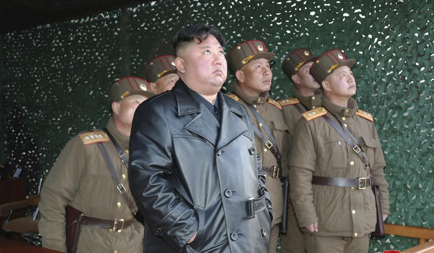 """In this photo provided by the North Korean government, North Korean leader Kim Jong Un inspects military exercise at an undisclosed location in North Korea on Saturday, March 21, 2020. Independent journalists were not given access to cover the event depicted in this image distributed by the North Korean government. The content of this image is as provided and cannot be independently verified. Korean language watermark on image as provided by source reads: """"KCNA"""" which is the abbreviation for Korean Central News Agency. (Korean Central News Agency/Korea News Service via AP)"""