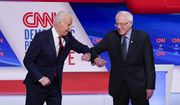 Former Vice President Joe Biden, left, and Sen. Bernie Sanders, I-Vt., right, greet one another before they participate in a Democratic presidential primary debate at CNN Studios in Washington, Sunday, March 15, 2020. (AP Photo/Evan Vucci) ** FILE **