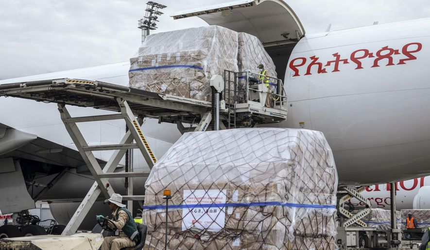 A cargo flight containing over 6 million medical items including face masks, test kits, face shields and protective suits arrives in the capital Addis Ababa, Ethiopia Sunday, March 22, 2020. The supplies arriving from Guangzhou, China for fighting the spread in Africa of the COVID-19 coronavirus were donated by the Jack Ma Foundation and Alibaba Foundation and will be distributed from Ethiopia to countries throughout Africa. (AP Photo/Mulugeta Ayene)
