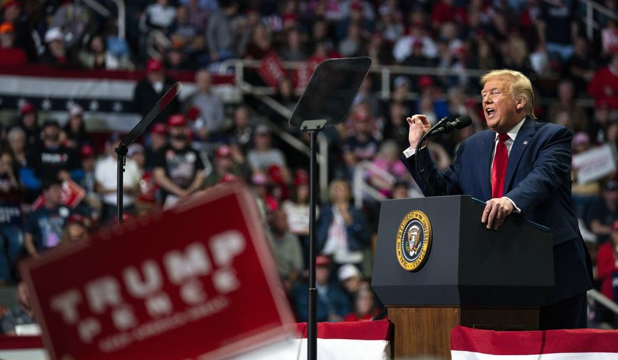 FILE - In this March 2, 2020, file photo President Donald Trump speaks during a campaign rally at Bojangles Coliseum in Charlotte, N.C. For the next seven months, Trump may be consigned to campaigning in a country beset by a fear of job loss, bankruptcy and disease. It will require a remarkable pivot for the president, who has relentlessly cheered the stock market's rise and the economy's strength as the central predicate for a second term. (AP Photo/Evan Vucci, File)