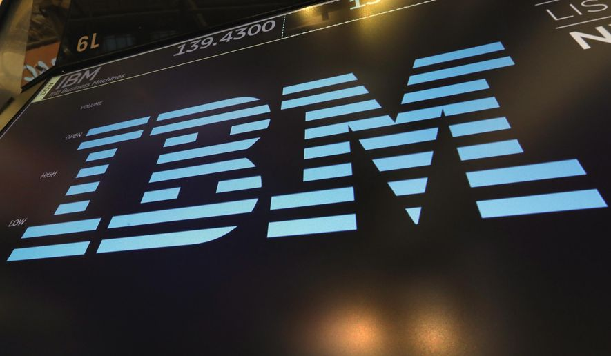 In this March 18, 2019, photo, the logo for IBM appears above a trading post on the floor of the New York Stock Exchange. IBM is offering up its speedy supercomputer to help combat the new coronavirus. The technology company said Sunday, March 22, 2020, that it is working with the White House and the U.S. Department of Energy to make its computing power more accessible to researchers tackling the coronavirus. (AP Photo/Richard Drew) **FILE**