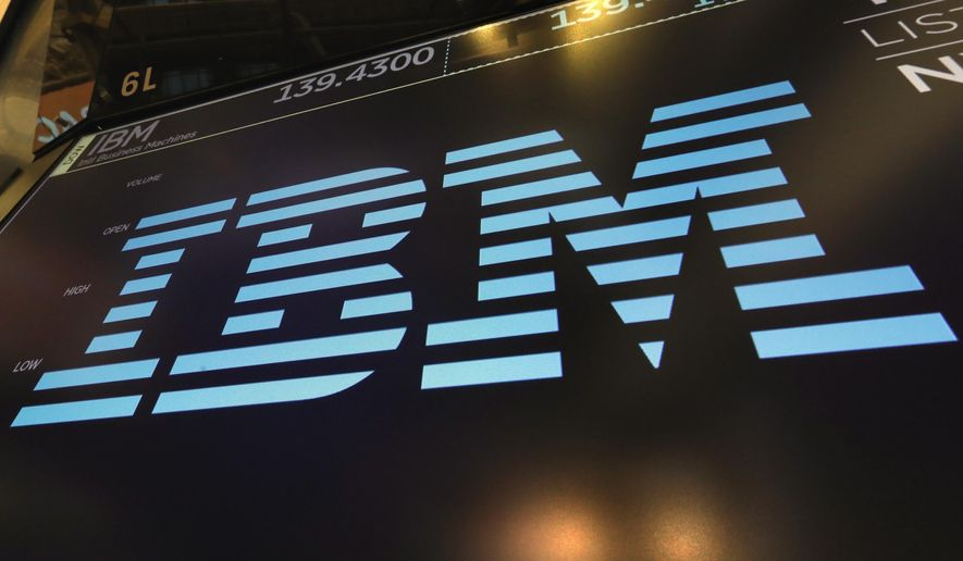 In this March 18, 2019, photo, the logo for IBM appears above a trading post on the floor of the New York Stock Exchange. (AP Photo/Richard Drew) ** FILE **