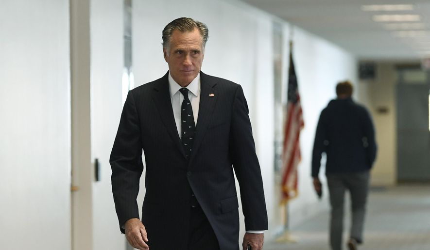 Sen. Mitt Romney, R-Utah, heads into a Republican policy lunch on Capitol Hill in Washington, Thursday, March 19, 2020. (AP Photo/Susan Walsh) **FILE**