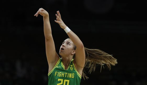 In this Feb. 1, 2020, file photo, Oregon guard Sabrina Ionescu (20) shoots in the first half of an NCAA college basketball game in Boulder, Colo. Ionescu was a unanimous choice Monday, March 23, 2020, as The Associated Press women's basketball player of the year. (AP Photo/David Zalubowski) ** FILE **