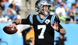 In this Dec. 15, 2019, file photo, Carolina Panthers quarterback Kyle Allen (7) passes against the Seattle Seahawks during the second half of an NFL football game in Charlotte, N.C. A person with knowledge of the move tells the Associated Press the Washington Redskins have acquired quarterback Kyle Allen, Monday, March 23, 2020, in a trade with the Carolina Panthers. (AP Photo/Mike McCarn, FIle)  **FILE**