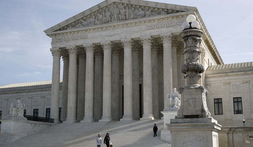 In this March 16, 2020, photo, people walk outside the Supreme Court in Washington. (AP Photo/Patrick Semansky) ** FILE **