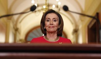 House Speaker Nancy Pelosi of Calif., arrives to speak outside her office on Capitol Hill, Monday, March 23, 2020. (AP Photo/Andrew Harnik, Pool)