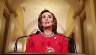 House Speaker Nancy Pelosi of California speaks outside her office on Capitol Hill, Monday, March 23, 2020. (AP Photo/Andrew Harnik, Pool)