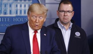 FEMA administrator Peter Gaynor listens as President Donald Trump speaks during a coronavirus task force briefing at the White House, Sunday, March 22, 2020, in Washington. (AP Photo/Patrick Semansky)