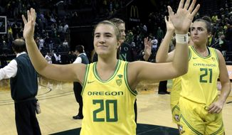 FILE - In this Nov. 16, 2019, file photo, Oregon's Sabrina Ionescu acknowledges the crowd with teammates after an NCAA college basketball game against Texas Southern in Eugene, Ore. Ionescu capped off a unprecedented college career by entering an exclusive club. Oregon's star guard was a unanimous choice Monday, March 23, 2020, as The Associated Press women's basketball player of the year. She was only the second player ever to the lone recipient of votes, joining Breanna Stewart, since the award was first given in 1995. (AP Photo/Chris Pietsch, FIle)
