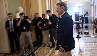 Sen. Rand Paul, R-Ky., walks on Capitol Hill in Washington, Tuesday, Feb. 25, 2020. (AP Photo/Susan Walsh)
