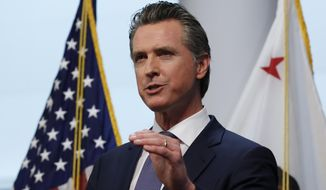 Gov. Gavin Newsom updates the state's response to the coronavirus at the Governor's Office of Emergency Services in Rancho Cordova, Calif., Monday, March 23, 2020. Newsom said he would close parking lots at dozens of beaches and state parks to prevent the spread of coronavirus after large groups flocked to the coast and mountains to get outdoors on the first weekend since the state's stay-at-home order took effect. (AP Photo/Rich Pedroncelli, Pool)