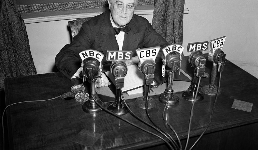 FILE - In this Feb. 27, 1941 file photo President Franklin D. Roosevelt speaks on the radio from the Oval Room of the White House. During an extraordinary 12 years in office, Roosevelt guided the nation through a bleak period of Depression-era unemployment, a severe Midwest drought known as the Dust Bowl and battle against the Nazis and Japanese in World War II. (AP Photo/Henry Griffin, File)