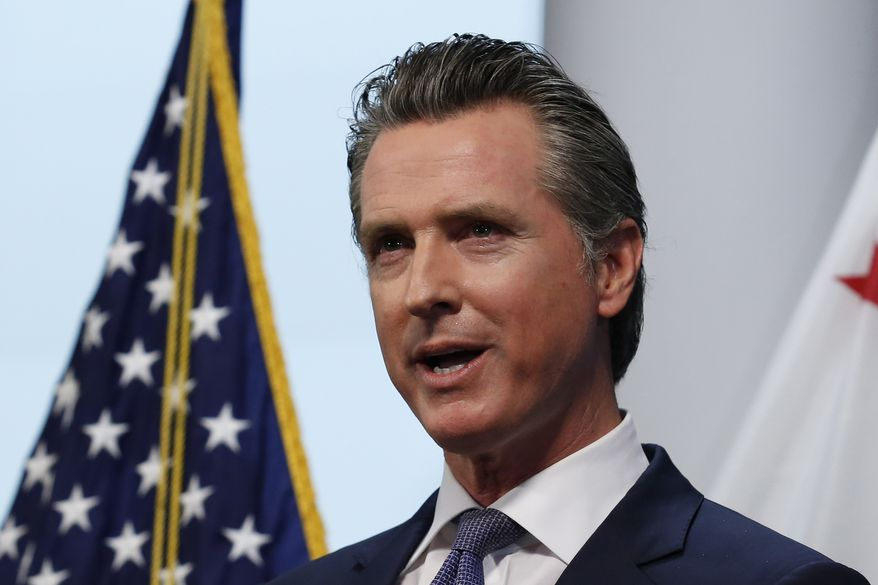 Gov. Gavin Newsom updates the state's response to the coronavirus at the Governor's Office of Emergency Services in Rancho Cordova, Calif., Monday, March 23, 2020. Newsom announced the closure of all state parking lots to discourage people from congregating at the state beaches and other public spaces during the coronavirus outbreak. (AP Photo/Rich Pedroncelli)