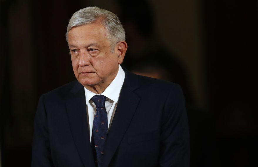 Mexico's President Andres Manuel Lopez Obrador arrives for his daily news conference at the presidential palace in Mexico City, Tuesday, March 24, 2020. Lopez Obrador's government is reluctant to implement some of the extreme measures and lockdowns seen in Europe or the United States to help stop the worldwide spread of the new coronavirus. (AP Photo/Marco Ugarte)