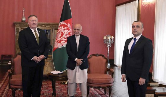 U.S. Secretary of State Mike Pompeo, left, stands with Afghan President Ashraf Ghani, center, and first Vice President Amrullah Saleh, at the Presidential Palace in Kabul, Afghanistan, Monday, March 23, 2020. Pompeo was in Kabul on an urgent visit Monday to try to move forward a U.S. peace deal signed last month with the Taliban, a trip that comes despite the coronavirus pandemic, at a time when world leaders and statesmen are curtailing official travel. (Afghan Presidential Palace via AP)