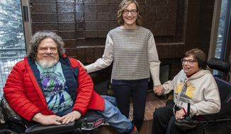 "FILE - This Jan. 24, 2020 file photo shows co-directors Jim LeBrecht, left, and Nicole Newnham, center, from the documentary ""Crip Camp"" with film subject Judith Heumann during the 2020 Sundance Film Festival in Park City, Utah. (Photo by Charles Sykes/Invision/AP, File)"