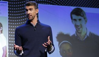 Michael Phelps speaks during a Panasonic news conference before the CES tech show, Monday, Jan. 6, 2020, in Las Vegas. (AP Photo/John Locher)