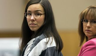 FILE - In this April 13, 2015, file photo, Jodi Arias, left, looks on next to her attorney, Jennifer Willmott, during her sentencing in Maricopa County Superior Court in Phoenix. The Arizona Court of Appeals on Tuesday, March 24, 2020, upheld Jodi Arias' first-degree murder conviction and life prison sentence in the gruesome 2008 killing of her former boyfriend. Arias' lawyers had argued that a prosecutor's misconduct and a judge's failure to control news coverage during the case deprived her of the right to a fair trial in the high-profile case. (Mark Henle/The Arizona Republic via AP, Pool, File)