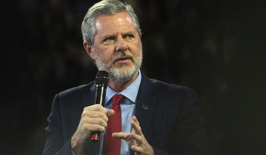 """In this, Nov. 13 2019, file photo, Liberty University President Jerry Falwell Jr. talks to Donald Trump Jr. about his new book """"Triggered"""" during convocation at Liberty University in Lynchburg, Va. Officials in Lynchburg said Tuesday they were fielding complaints and concerns about the hundreds of students that have returned from their spring break to Liberty University, where President Jerry Falwell Jr. has welcomed them back amid the coronavirus pandemic. (Emily Elconin/The News & Advance via AP)"""