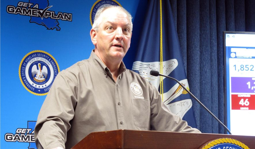 Louisiana Gov. John Bel Edwards talks about the state's response to the coronavirus outbreak, Tuesday, March 24, 2020, in Baton Rouge, La. The Democratic governor requested a federal disaster declaration for his state, which has one of the nation's highest per-capita rates of virus infection. (AP Photo/Melinda Deslatte)