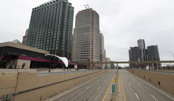 Empty roads leading into Detroit are shown Tuesday, March 24, 2020. Gov. Gretchen Whitmer told Michigan residents to stay at home beginning Tuesday, in her most sweeping order of the coronavirus crisis. (AP Photo/Paul Sancya)