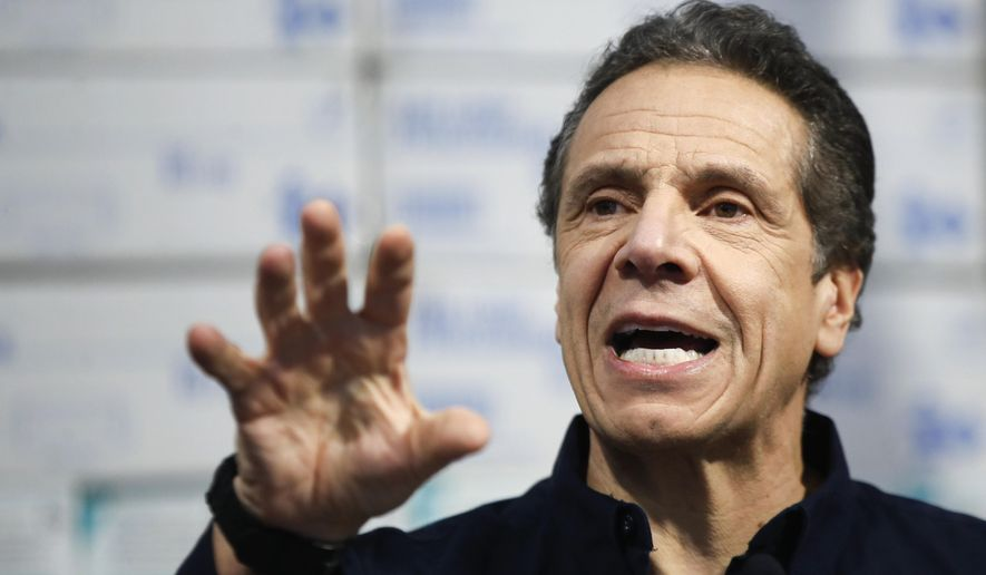 New York Gov. Andrew Cuomo speaks during a news conference against a backdrop of medical supplies at the Jacob Javits Center that will house a temporary hospital in response to the COVID-19 outbreak, Tuesday, March 24, 2020, in New York. Cuomo sounded his most dire warning yet about the coronavirus pandemic, saying the infection rate in New York is accelerating and the state could be as close as two weeks away from a crisis that projects 40,000 people in intensive care. (AP Photo/John Minchillo) **FILE**