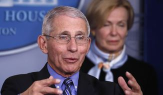 Dr. Anthony Fauci, director of the National Institute of Allergy and Infectious Diseases, speaks about the coronavirus in the James Brady Briefing Room, Tuesday, March 24, 2020, in Washington, as Dr. Deborah Birx, White House coronavirus response coordinator, listens. (AP Photo/Alex Brandon)