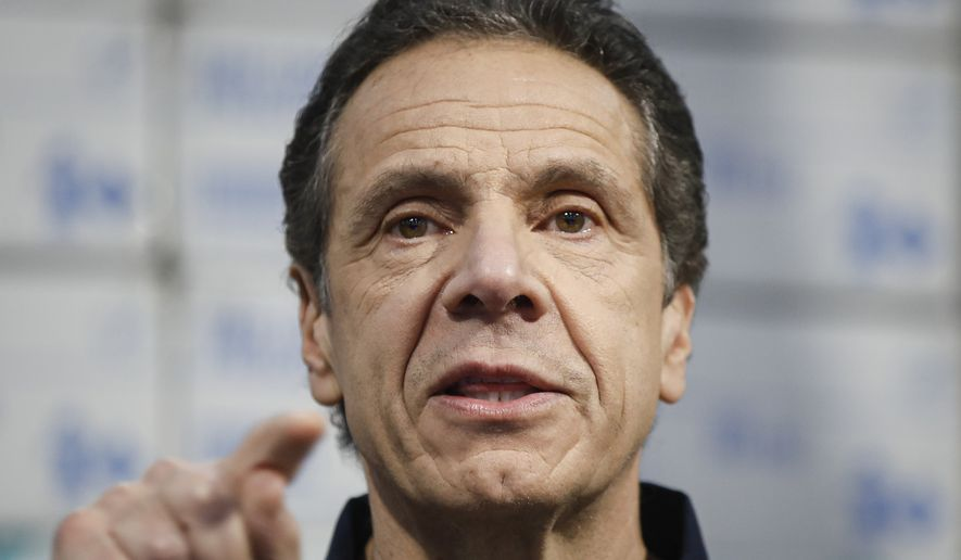 New York Gov. Andrew Cuomo speaks during a news conference at the Jacob Javits Center that will house a temporary hospital in response to the COVID-19 outbreak, Tuesday, March 24, 2020, in New York. (AP Photo/John Minchillo) ** FILE **