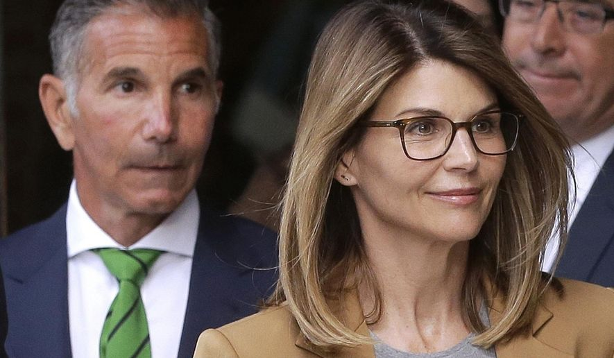 "FILE - In this April 3, 2019, file photo, actress Lori Loughlin, front, and her husband, clothing designer Mossimo Giannulli, left, depart federal court in Boston. ""Full House"" actress Loughlin, Giannulli and other prominent parents told a judge Wednesday, March 25, 2020, that he should dismiss charges against them in the college admissions bribery case, accusing prosecutors of ""extraordinary"" misconduct. (AP Photo/Steven Senne, File)"
