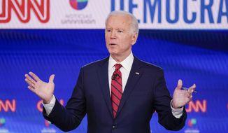 Former Vice President Joe Biden, participates in a Democratic presidential primary debate at CNN Studios in Washington, Sunday, March 15, 2020. (AP Photo/Evan Vucci) ** FILE **
