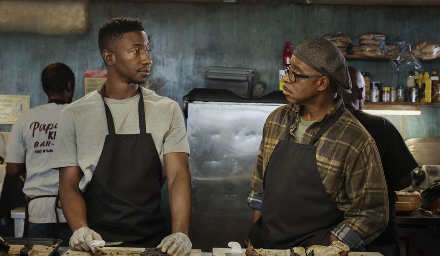 "This image released by Netflix shows Mamoudou Athie, left, and Courtney B. Vance in a scene from ""Uncorked."" (Nina Robinson/Netflix via AP)"