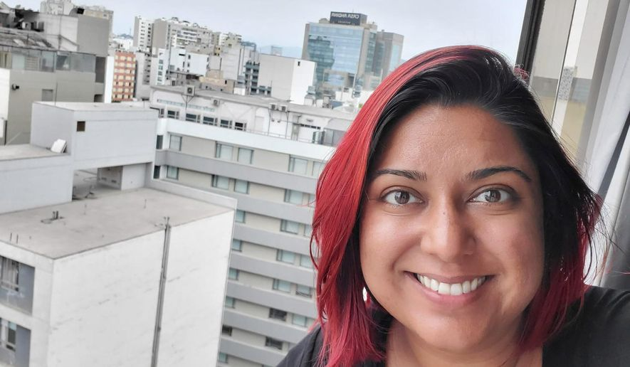 In this undated selfie provided by Jessica Brar, she looks out from her room at the Selina Miraflores Hostel in Lima, Peru. Brar, a 34 year-old Gainesville, Fla., yoga instructor is stranded in Peru, after the country enforced a mandatory country-wide quarantine to help stave the spread of COVID-19, the disease caused by the new coronavirus, The U.S. Embassy has shuttered and Brar feels abandoned by her country. (Jessica Brar via AP)