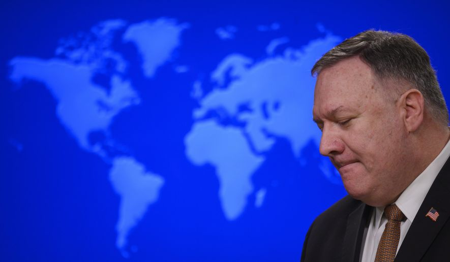 "Secretary of State Mike Pompeo speaks during a news conference at the State Department on Wednesday, March 25, 2020, in Washington. Pompeo said Wednesday that the Group of Seven members were all aware of China's ""disinformation campaign"" regarding the coronavirus outbreak, as the two countries dispute the origins of the disease. (Andrew Caballero-Reynolds/Pool Photo via AP)"