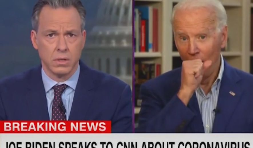 CNN host Jake Tapper called out Democratic presidential front-runner Joseph R. Biden for coughing into his hand during a live interview Tuesday as the country is being urged to adopt safer health practices during the coronavirus pandemic. (Screengrab CNN)