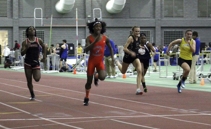 FILE - In this Feb. 7, 2019 file photo, Bloomfield High School transgender athlete Terry Miller, second from left, wins the final of the 55-meter dash over transgender athlete Andraya Yearwood, far left, and other runners in the Connecticut girls Class S indoor track meet at Hillhouse High School in New Haven, Conn. In a response to a lawsuit brought by three female high school runners, the Connecticut Interscholastic Athletic Conference maintains that it is exempt from Title IX, that guarantees equal access to women and girls in education, including athletics. The lawsuit argues that male anatomy gives the transgender runners an unfair advantage in violation of Title IX. (AP Photo/Pat Eaton-Robb, File)