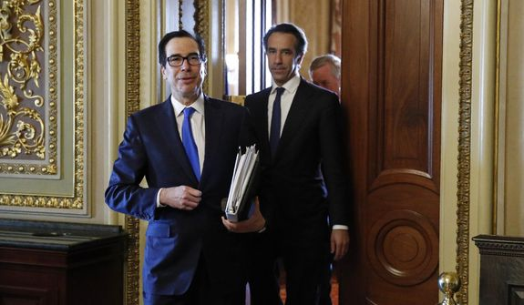 Treasury Secretary Steve Mnuchin steps out of a meeting on Capitol Hill in Washington, Tuesday, March 24, 2020, as the Senate works to pass a coronavirus relief bill. (AP Photo/Patrick Semansky)