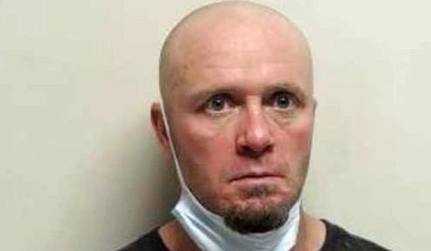 This photo released by the Utah County Sheriff's Office shows Joshua Haskell, who is charged with kidnapping and burglary after authorities say he broke into a woman's house in American Fork, Utah, on March 19, 2020. He had been let out of a halfway house two days earlier due to the spread of the coronavirus. (Utah County Sheriff's Office via AP)