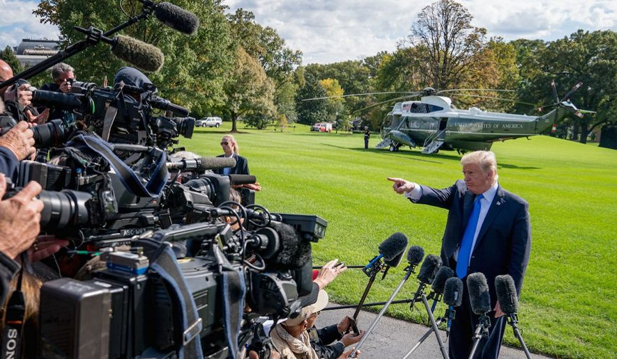 A new Gallup poll finds President Trump with a vastly higher approval rating than the news media. (Associated Press)