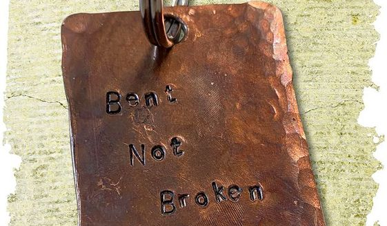 Bent not Broken Keyring illustration by Linas Garsys / The Washington Times